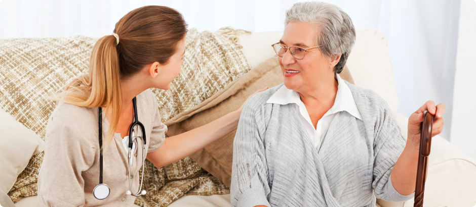 An elderly talking to a caregiver